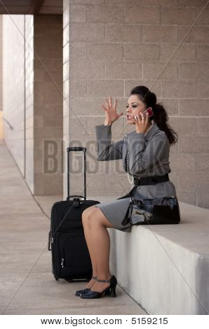 Angry Hispanic Woman Traveler Talking On Cell Phone