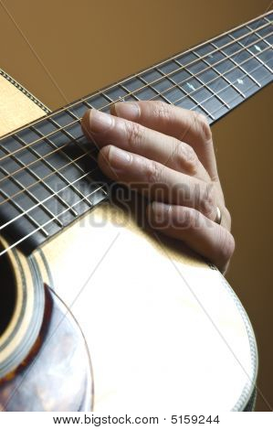 Hand On Acoustic Guitar