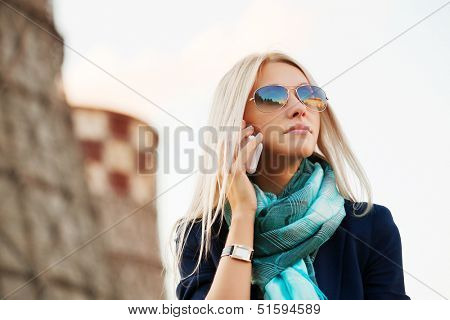 Blond business woman calling on the phone
