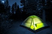 stock photo of survival  - Small Camping Tent Illuminated Inside - JPG