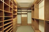 picture of master bedroom  - Large master bedroom closet with wood paneling - JPG