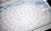 stock photo of northern hemisphere  - Astronomical paper star map fragment with constellations names on Russian