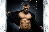 stock photo of cataracts  - the very muscular handsome sexy guy under shower naked torso - JPG