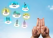 Cheerful happy smiling fingers with sightseeing landmarks icons poster