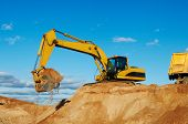 pic of dumper  - excavator machine loading dumper truck at sand quarry - JPG