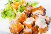 stock photo of pork belly  - crispy fried pork belly and oriental salad on a side - JPG