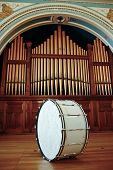 picture of pipe organ  - Large Bass Drum sitting on stage in front of Pipe Organ - JPG