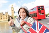 picture of westminster bridge  - London tourist woman holding shopping bag near showing thumbs up sign happy excited near Big Ben - JPG