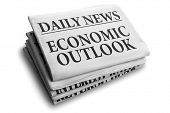 stock photo of newspaper  - Daily news newspaper headline reading economic outlook concept for financial forecasting - JPG