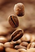 image of coffee crop  - Coffee beans falling into a heap - JPG