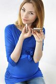 stock photo of fondling  - Beauty pregnant woman doing makeup on the white background - JPG