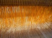 stock photo of loom  - The threads in the old weaving loom - JPG