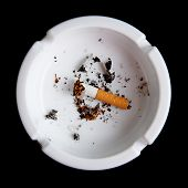 picture of non-toxic  - Cigarette in an ashtray on a black background