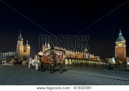 Hansom Cab At Night On Old Town Square In Krakow, Poland.
