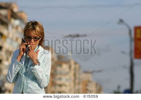 Business Women Walking On The Street, Talking On The Phone And S