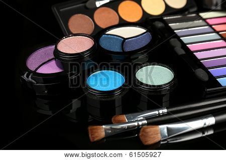 Bright eye shadows on black background