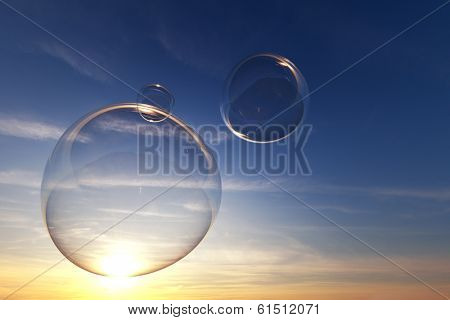 Clear soap bubbles in the sky with sunset