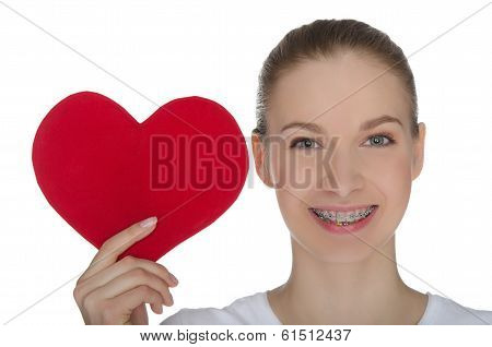 Happy Girl With Braces On Teeth And Red Heart
