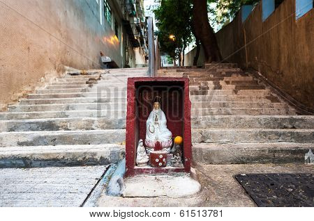 Statue of the Goddess of Mercy Guanyin in a Hong Kong street shrine