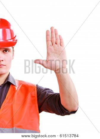Man Worker In Safety Vest And Hard Hat Showing Stop Hand