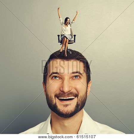 happy young woman sitting on the head of her smiley boyfriend