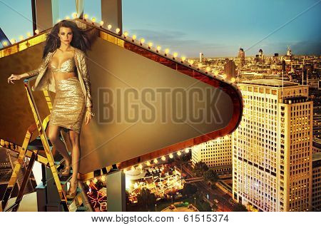 Beautiful woman standing on the ladder