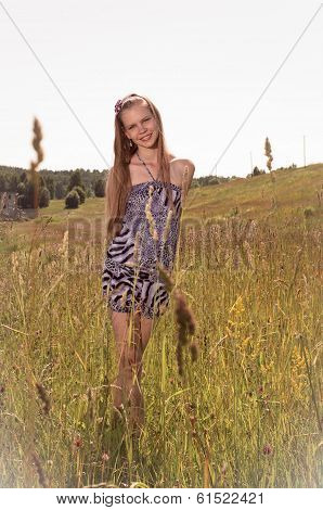 young teen girl in the field