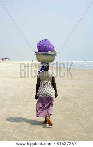 A Woman From Ghana African Nest On His Head Heavy Load.