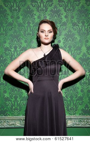 Brunette Model Posing In Green Vintage Room