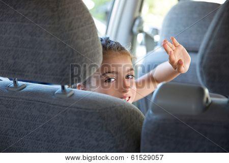 Kid children girl happy greeting gesture hand in car vehicle indoor