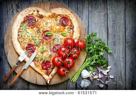 Pizza heart shape with cheese and tomato