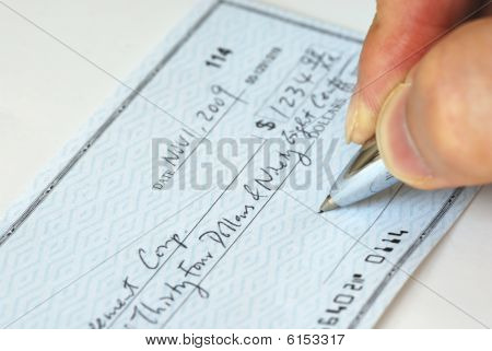 Writing a check to pay for the bill