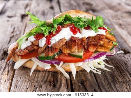 Doner Kebab - grilled meat, bread and vegetables