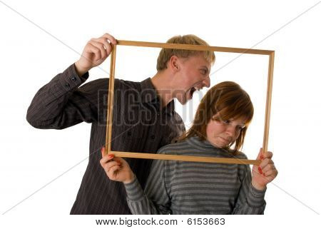 Young Couple Posing And Playing Tricks