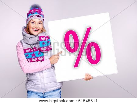 Woman In Warm Outerwear  Holds The Banner With Per?ent Symbol