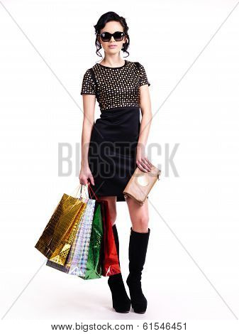 Fashionable Young Woman With Purchases In Hands.