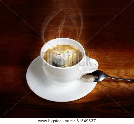 Hot Fresh Coffee In A White Cup With Spoon On Wooden Table