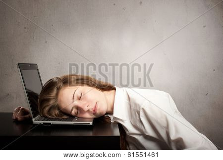 businesswoman sleeping on laptop on gray background