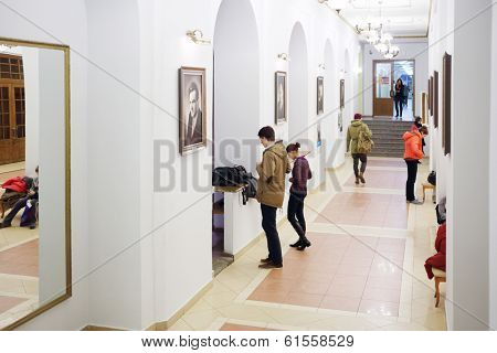 MOSCOW, RUSSIA - NOV 21, 2013: Students in hallway of Russian State University of Cinematography. First in world state film school was founded in 1919 in Moscow.