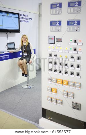 MOSCOW, RUSSIA - DEC 4, 2013: Woman at stand of company at Exhibition Electrical Networks of Russia - 2013 in exhibition center MosExpo (VVC).