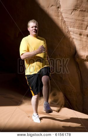 Man Jogging In Sand