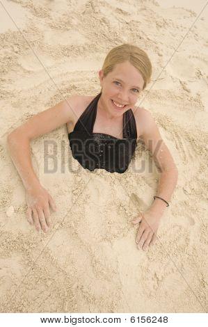 Girl In Sand