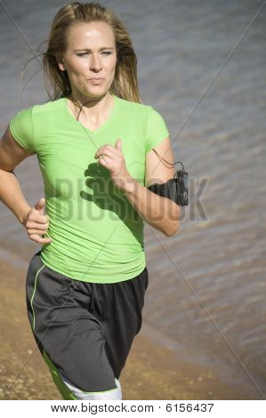 Woman Jogs With Music
