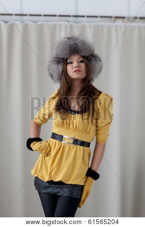 A girl in a fur hat