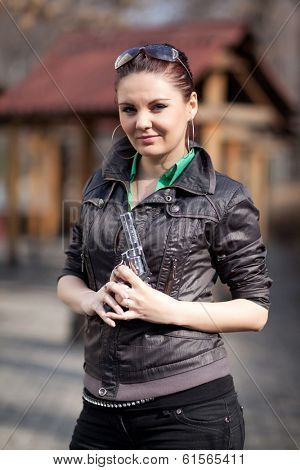 A girl with a gun in park