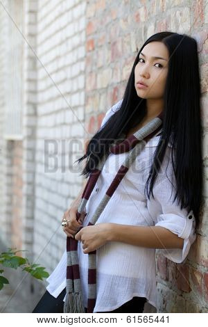 Beautiful girl against a wall