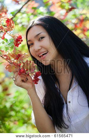 Portrait of a girl in the garden. Viburnum. Rowan