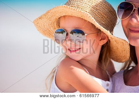 Young mother and her adorable little daughter on summer vacation
