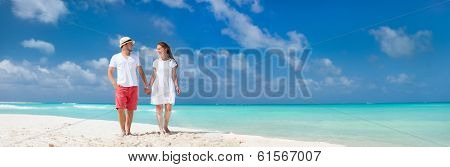 Young couple tropical at beach during summer vacation