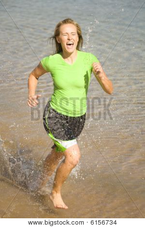 Woman Racing In Water